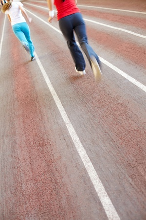 Image of race track with blurred running silhouettes Stock Photo - 9263128