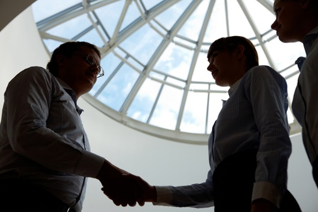 join the team: Outlines of business people handshaking after making agreement