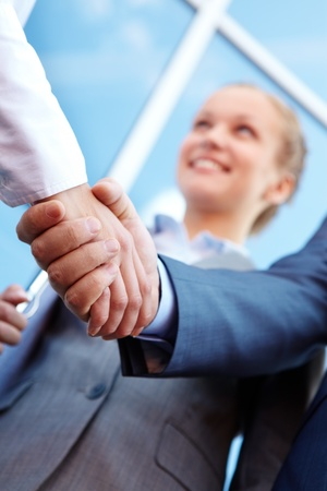 Photo of successful associates handshaking after striking deal outdoors at meeting Stock Photo - 9263271