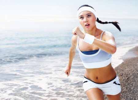 A young woman running near the sea  Stock Photo - 9263331