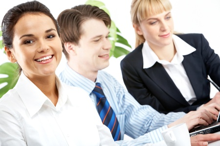 Photo of businesswoman looking at camera during work  photo