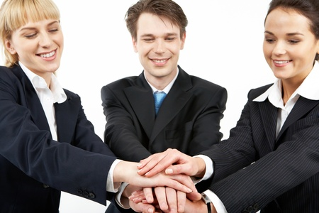 Portrait of smiling business partners with a pile of their hands  Stock Photo - 9298485