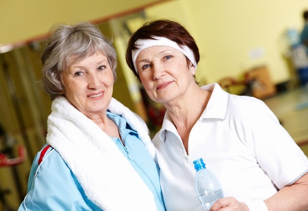 gracious: Portrait of senior females looking at camera in gym Stock Photo