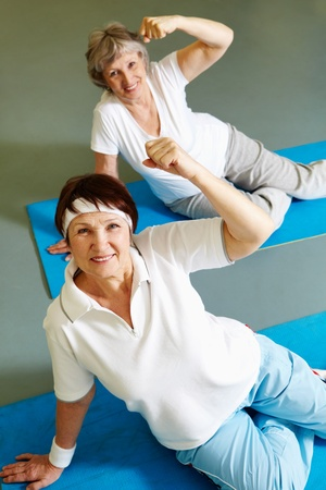 Portrait of sporty females doing physical exercise in sport gym Stock Photo - 9298503