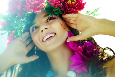Beautiful woman with bright flowers in good mood Stock Photo - 9298559