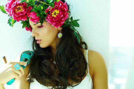 wrath: Beautiful woman in floral wrath looking aside