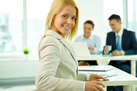 Portrait of a young beautiful businesswoman in working environment Stock Photo - 9298630
