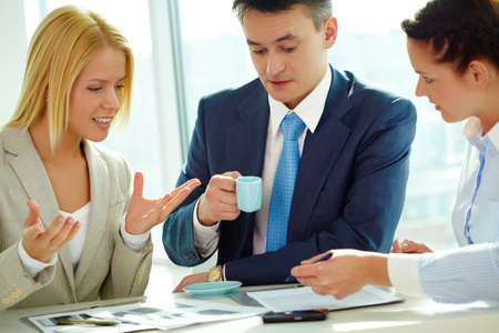 Group of business partners sitting and planning work Stock Photo - 9298646