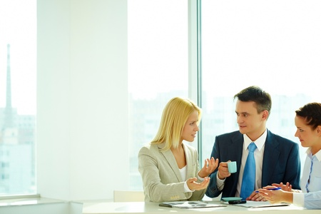 Smart woman explaining her idea to colleagues in office Stock Photo - 9298597