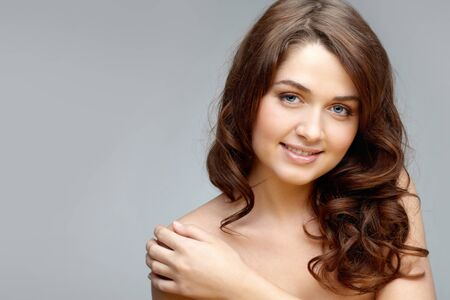 Portrait of feminine woman touching her shoulder and looking at camera Stock Photo - 9298651