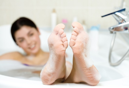 Image of soles of woman having pleasant bath with foam Stock Photo - 9298618