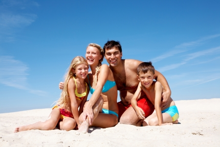 Photo of happy family sitting on sand on summer vacation Stock Photo - 9298629