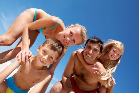 Photo of happy family looking at camera during summer vacation Stock Photo - 9298634