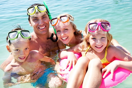 Portrait of cheerful family in aqualungs looking at camera with smiles Stock Photo - 9298625