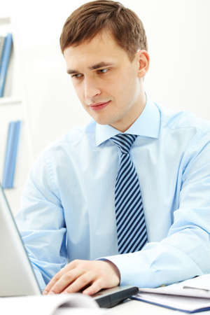 Confident businessman looking at laptop monitor Stock Photo - 9318471