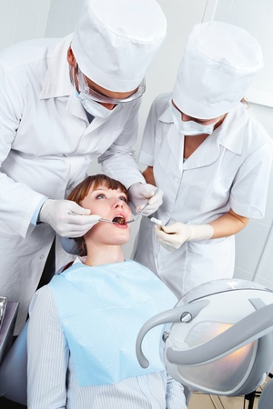 Image of  woman opening her mouth and doctor and nurse checkup her teeth  Stock Photo - 9318461
