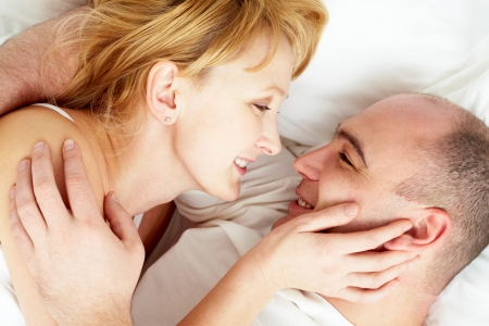 beautiful bed: Close-up of wife and husband looking at each other with love