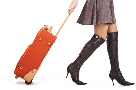 walking boots: Photo of elegant female carrying red suitcase