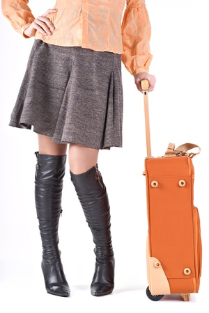 Image of stylish woman with her suitcase  photo