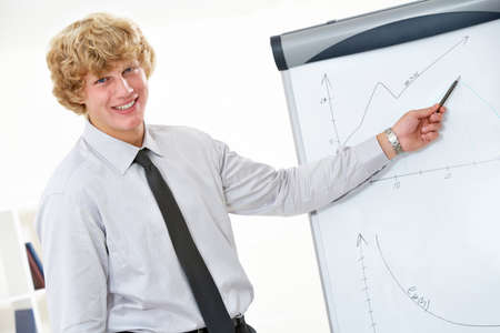 Image of successful businessman showing his project at whiteboard  photo