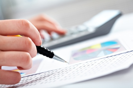 accountant: Close-up of specialist checking a financial analyze