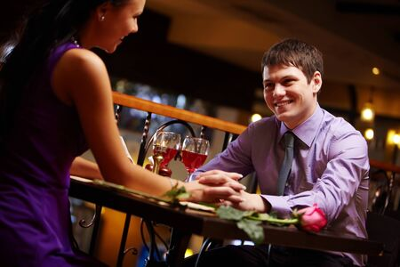 Portrait of amorous couple holding by hands in the cafe Stock Photo - 9319388