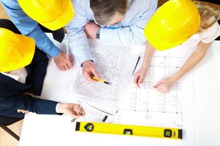 discuss: Above view of architects planning a house project  Stock Photo