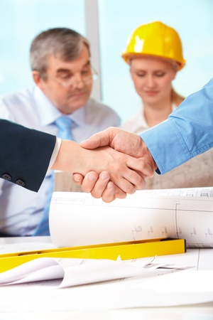 Image of customer and architect handshaking after making an agreement  photo