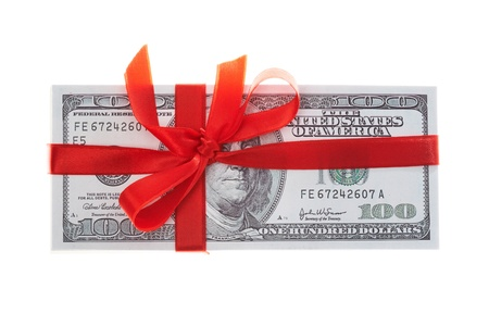 pack of dollars decorated with red ribbon over white background photo