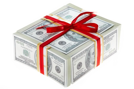 Photo of box made up of dollars decorated with red ribbon over white background photo
