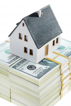 Close-up of toy house model on top of dollar stack Stock Photo - 9331627