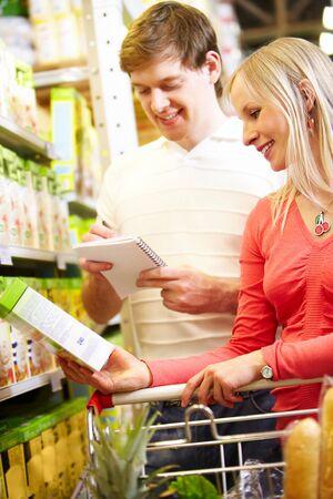 Image of happy couple choosing porridge Stock Photo - 9331613