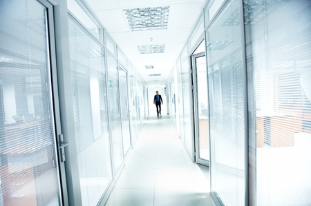 go inside: A businessman walking in the office corridor Stock Photo