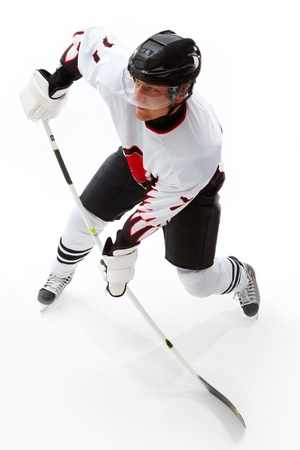 ice skate: Portrait of healthy sportsman playing hockey on ice