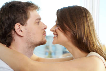 Half faces of man and woman looking at each other  photo