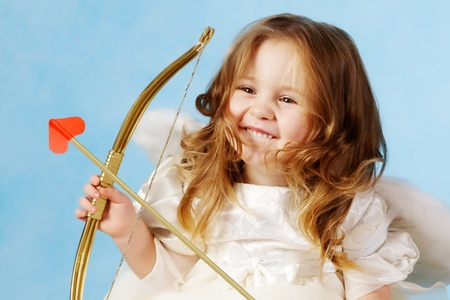 seraphic: Cute female cupid holding bow  Stock Photo