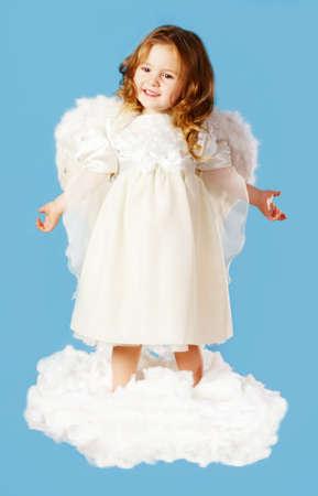 angel alone: Portrait of cute little cupid standing on cloud