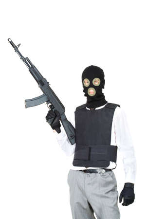 Portrait of terrorist in balaclava holding rifle on white background Stock Photo - 9360194
