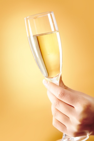 Photo of female hand holding flute of champagne  photo