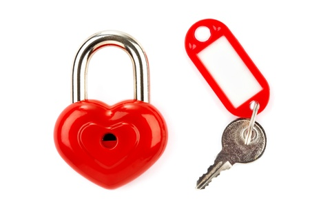 Red lock and key isolated on a white background  photo