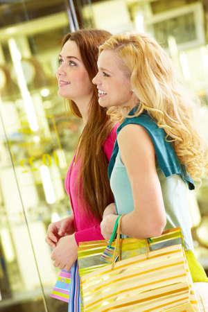 Two young beautiful women shopping together photo