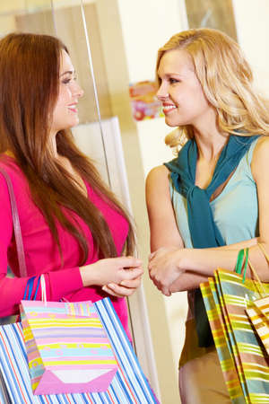 Image of two women talking in shop photo