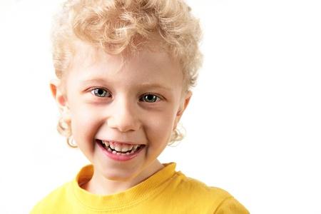 Portrait of joyful lad laughing in yellow t-shirt  Stock Photo - 9368278