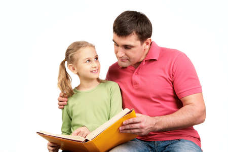 Portrait of loving father reading book together with his daughter photo