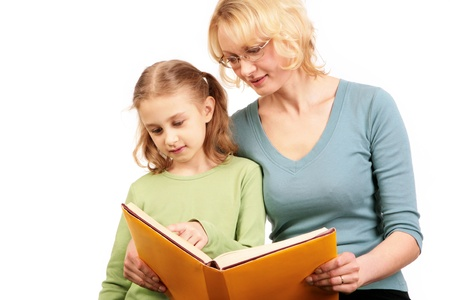 Portrait of loving mother reading book together with his daughter photo