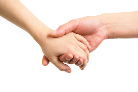 gentleness: Close-up of mother and child holding by hands  Stock Photo