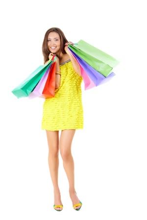 Photo of glamorous shopper with lots of bags isolated on white background Stock Photo - 9374352