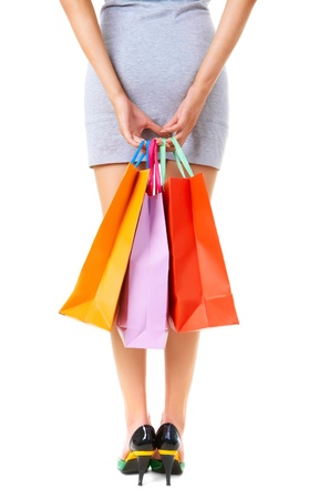 Rear view of female hands with colorful paperbags Stock Photo - 9374356