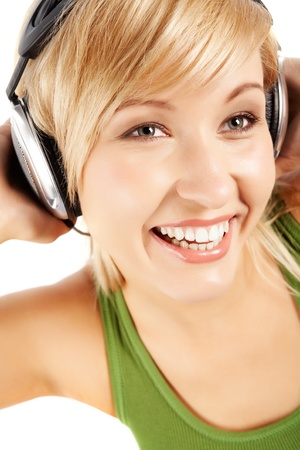 Cheerful girl in headphones listening to music  photo