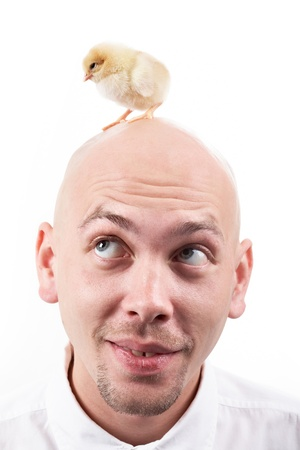 Portrait of handsome man with little chick Stock Photo - 9380422
